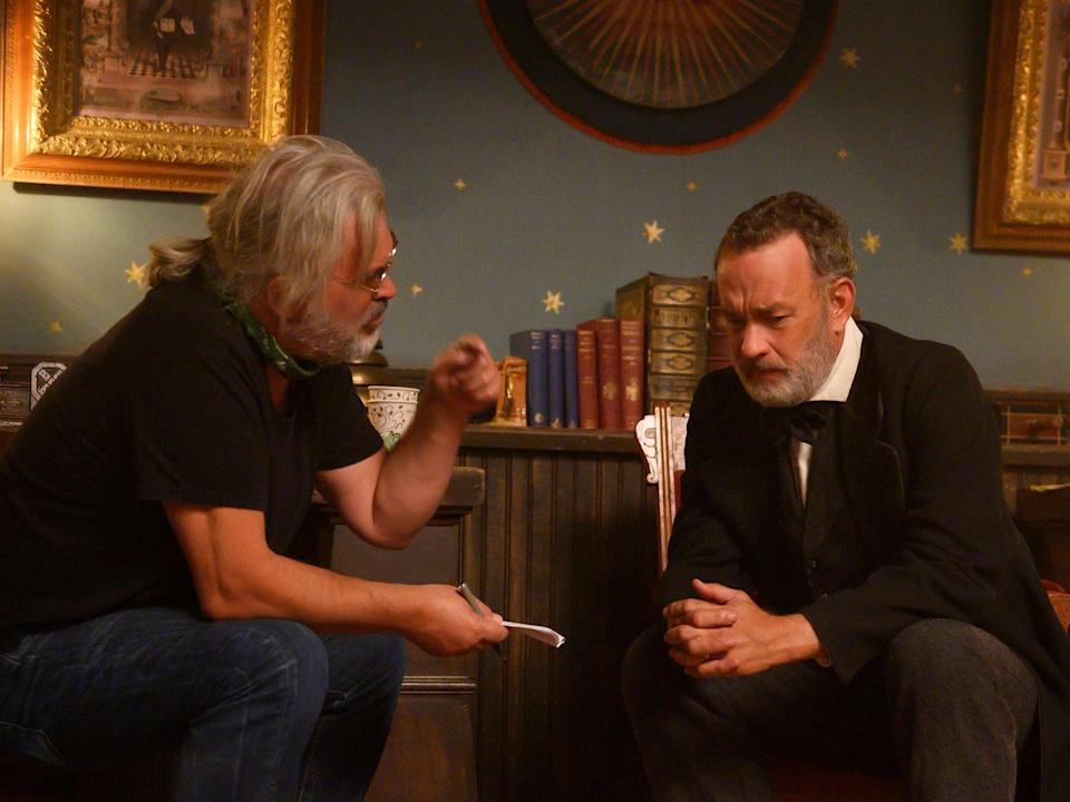 <p>Filmmaker Paul Greengrass with Tom Hanks on the set of 'News of the World'</p> (Bruce W Talamon/Universal Pictures/Netflix)