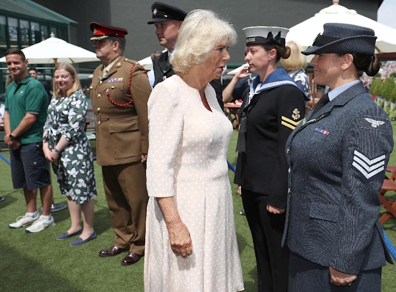 Britain's Camilla, Duchess of Cornwall talks with Seargeant Kelly Griffith as she meets officials, ball boys and girls, and military personnel working at  Wimbledon