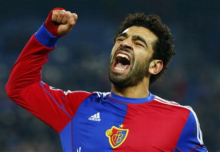 FC Basel's Mohamed Salah celebrates scoring against Chelsea's during their Champions League Group E soccer match at St. Jakob-Park in Basel November 26, 2013. REUTERS/Ruben Sprich