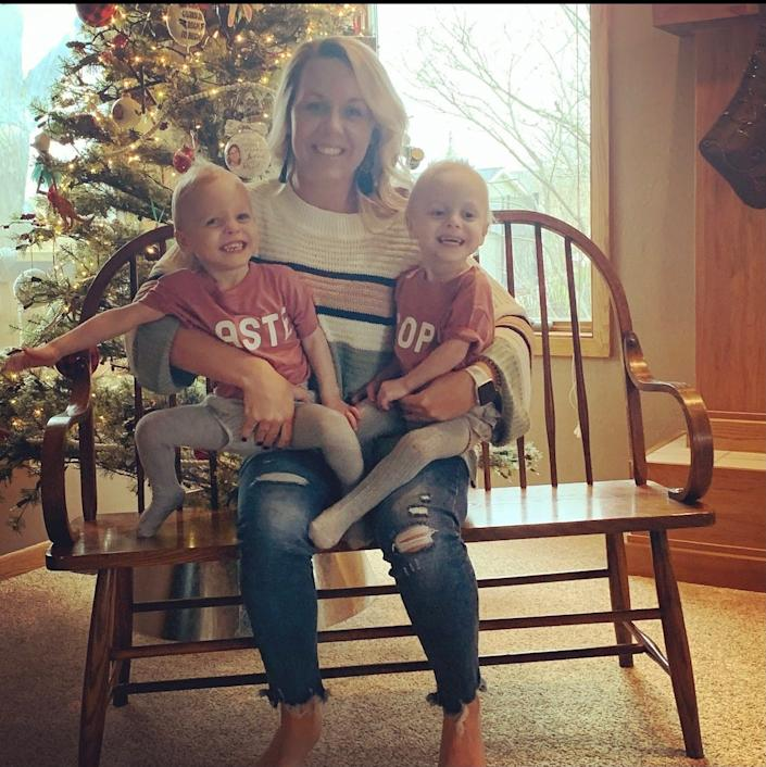 Twin sisters Keeley, left, and Kambry sit on the lap of their mom, Jade Ewoldt. The world's most premature twins, born at the University of Iowa Stead Family Children's Hospital, will turn 2 on Nov. 24, 2020.