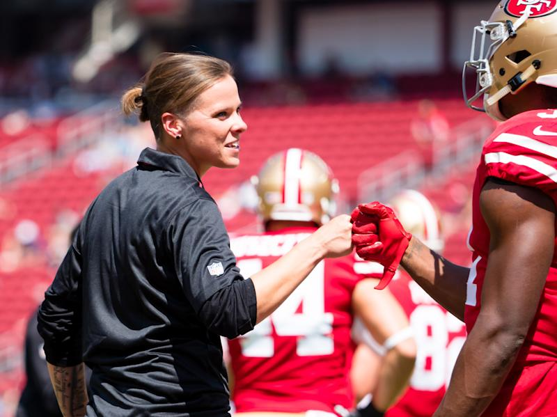 Sep 10, 2017; Santa Clara, CA, USA; San Francisco 49ers seasonal offensive assistant Katie Sowers fist bumps running back Raheem Mostert (31) before the game against the Carolina Panthers at Levi's Stadium. Mandatory Credit: Kelley L Cox-USA TODAY Sports