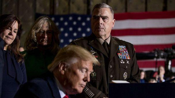 PHOTO: Joint Chiefs Chairman Gen. Mark Milley, top center, watches as President Donald Trump signs the National Defense Authorization Act for Fiscal Year 2020 at Andrews Air Force Base, Md., Dec. 20, 2019. (Andrew Harnik/AP, FILE)