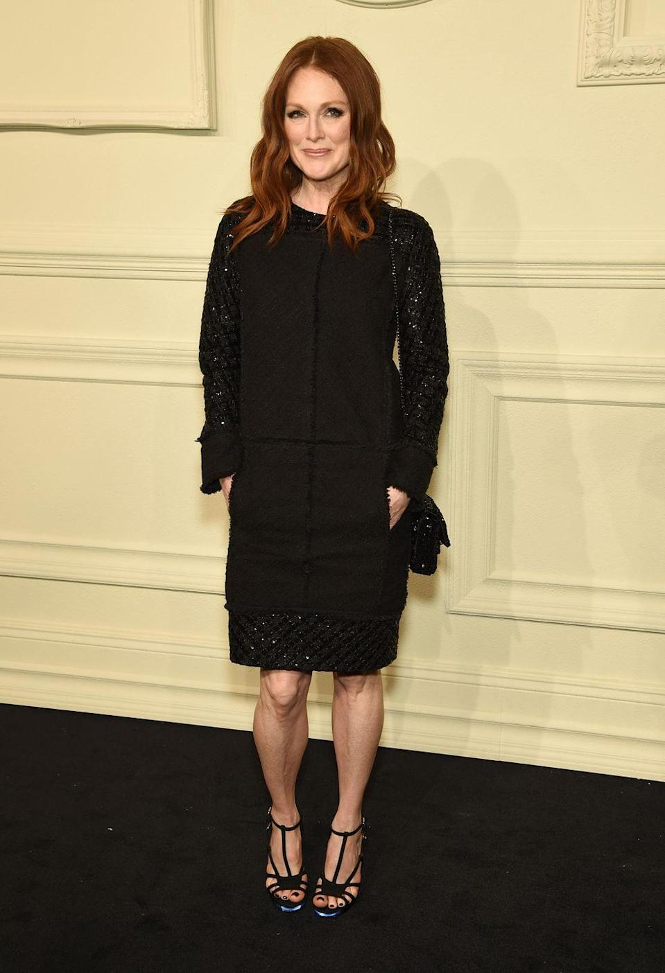 <p>Coco Chanel is the mother of the little black dress, and the fashion house continues to create gorgeous pieces today. Julianne Moore wears one of their tweed and sequin sheath designs at their fashion show in 2015. </p>