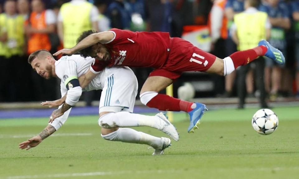 Sergio Ramos tussles with Liverpool's Mohamed Salah in the 2018 Champions League final.