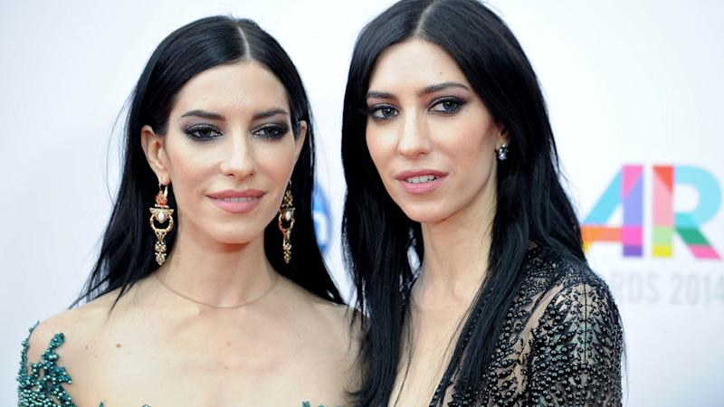 Lisa (left) and Jessica Origliasso of the The Veronicas were kicked off a Qantas plane following an argument. Source: AAP