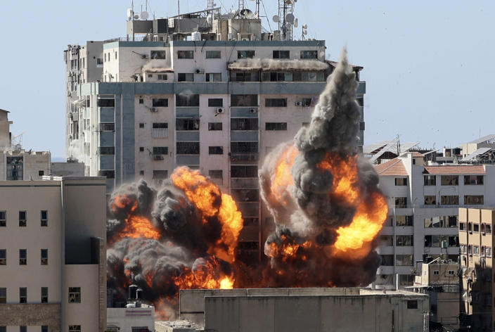 A ball of fire erupts from a building housing various international media, including The Associated Press, after an Israeli airstrike on Saturday, May 15, 2021 in Gaza City. The attack came roughly an hour after the Israeli military ordered people to evacuate the building, which also housed Al-Jazeera and a number of offices and apartments. There was no immediate explanation for why the building was targeted. (Mahmud Hams /Pool Photo via AP)