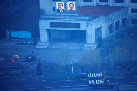 Military trucks carry soldiers through central Pyongyang before sunset as the capital preparers for a parade marking today's 105th anniversary of the birth of Kim Il Sung, North Korea's founding father and grandfather of the current ruler, April 15, 2017.    REUTERS/Damir Sagolj