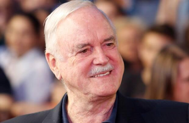 Actor, comedian and screenwriter John Cleese is looking for a rental in Huntsville, Ont., while filming a movie in the area after an Airbnb mishap left him without a place to stay. (Amel Emric/The Associated Press - image credit)