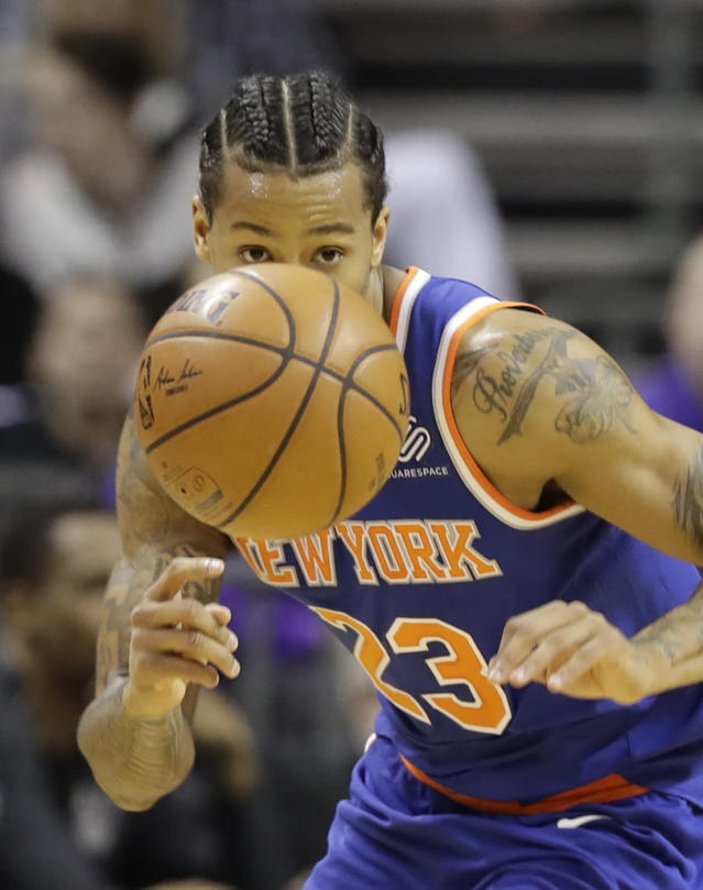 New York Knicks' Trey Burke (23) may or may not have checked into a Charlotte hotel using the alias Allan Iversun. (AP Photo/Chuck Burton)