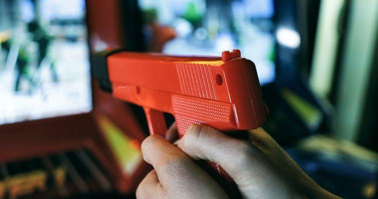 """<span class=""""caption"""">Video games' affect on moral reasoning goes beyond how violent they are.</span> <span class=""""attribution""""><a class=""""link rapid-noclick-resp"""" href=""""https://www.shutterstock.com/image-photo/group-young-adults-arcade-playing-pinball-1428825122"""" rel=""""nofollow noopener"""" target=""""_blank"""" data-ylk=""""slk:Sean Locke Photography/Shutterstock"""">Sean Locke Photography/Shutterstock</a></span>"""