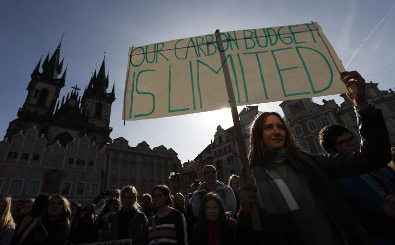 A girl holds a sign during a protest at the Old Town Square in Prague, Czech Republic, Friday, Sept. 20, 2019. Several hundreds of protestors gathered in response to a day of worldwide demonstrations calling for action to guard against climate change. (AP Photo/Petr David Josek)