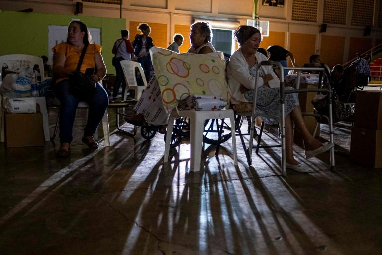 People are seen at a shelter set up after an earthquake damaged several houses in Guanica, Puerto Rico on January 6