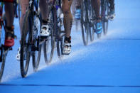Water trails off the bikes as Valerie Barthelemy of Belgium competes during the women's individual triathlon competition at the 2020 Summer Olympics, Tuesday, July 27, 2021, in Tokyo, Japan. (AP Photo/David Goldman)