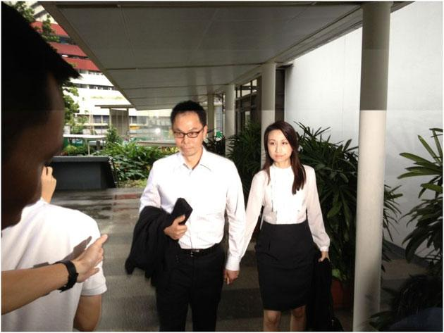 <p>Former CNB chief Ng Boon Gay and his wife arrive at the subordinate courts for his verdict in the sex-for-contracts case. He was found not guilty. (Yahoo! photo)</p>