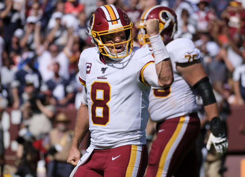 Washington Redskins quarterback Case Keenum (8) celebrates after throwing a touchdown pass to wide receiver Paul Richardson in the second half of an NFL football game against Dallas Cowboys, Sunday, Sept. 15, 2019, in Landover, Md. (AP Photo/Evan Vucci)