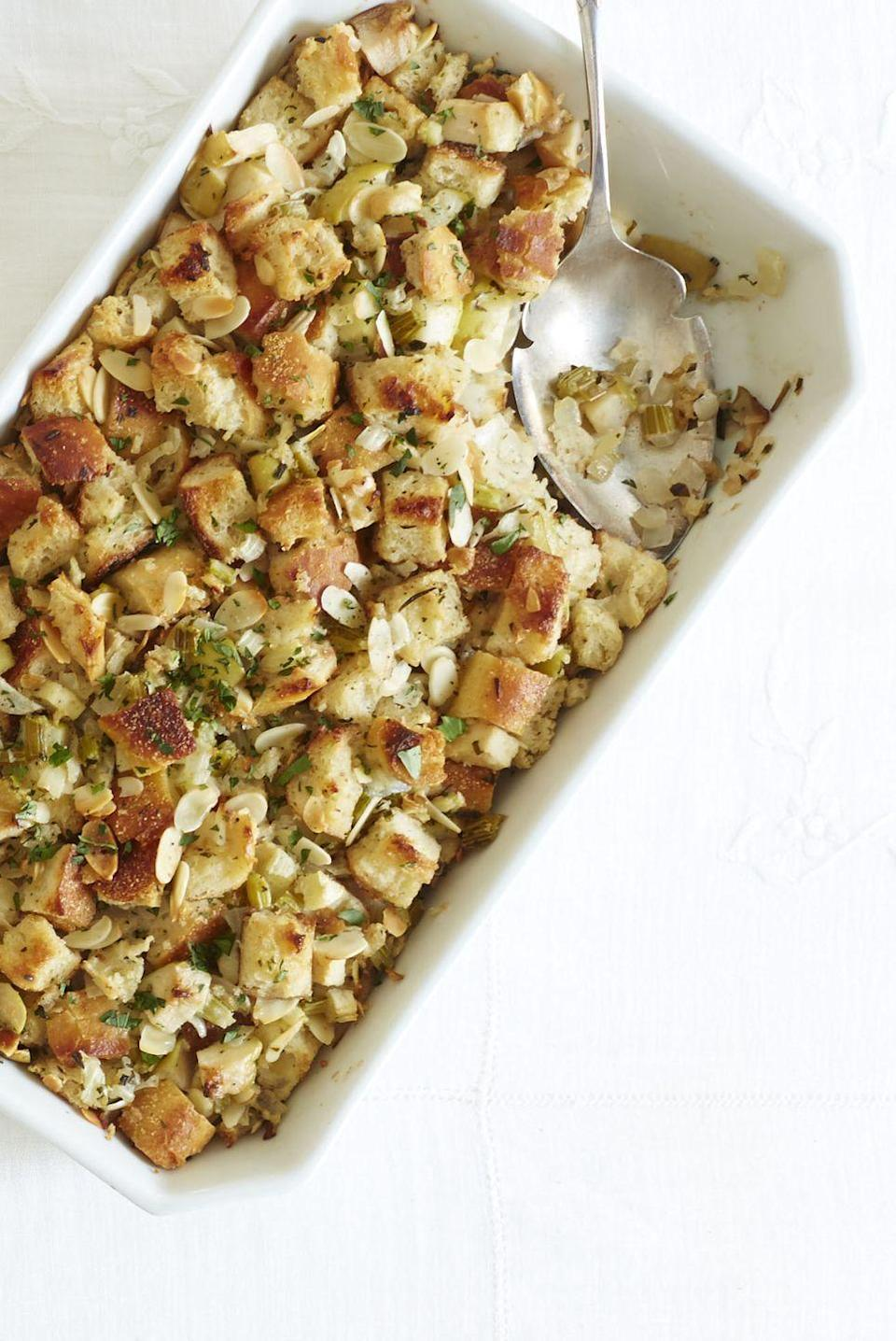 """<p>This fall stuffing is studded with fresh seasonal flavor. Apples lend it sweetness, while almonds give it a crunch. <br></p><p><em><a href=""""https://www.goodhousekeeping.com/food-recipes/a15424/herb-apple-stuffing-recipe-ghk1113/"""" rel=""""nofollow noopener"""" target=""""_blank"""" data-ylk=""""slk:Get the recipe for Herb and Apple Stuffing »"""" class=""""link rapid-noclick-resp"""">Get the recipe for Herb and Apple Stuffing »</a></em></p><p><strong>RELATED: </strong><a href=""""https://www.goodhousekeeping.com/holidays/thanksgiving-ideas/g2763/leftover-stuffing-recipes/"""" rel=""""nofollow noopener"""" target=""""_blank"""" data-ylk=""""slk:20 Leftover Stuffing Recipes to Make After Thanksgiving"""" class=""""link rapid-noclick-resp"""">20 Leftover Stuffing Recipes to Make After Thanksgiving</a></p>"""