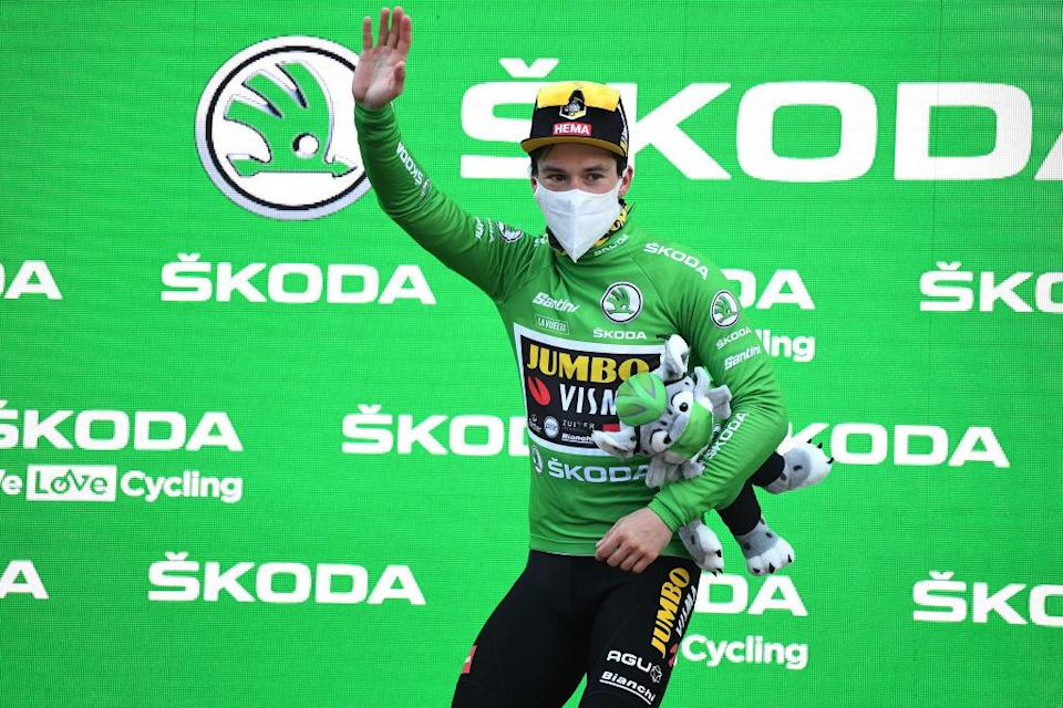 VILLANUEVA DE VALDEGOVIA SPAIN  OCTOBER 27 Podium  Primoz Roglic of Slovenia and Team Jumbo  Visma Green Points Jersey  Celebration  Mascot  during the 75th Tour of Spain 2020 Stage 7 a 1597km from VitoriaGasteiz to Villanueva de Valdegovia  lavuelta  LaVuelta20  La Vuelta  on October 27 2020 in Villanueva de Valdegovia Spain Photo by David RamosGetty Images