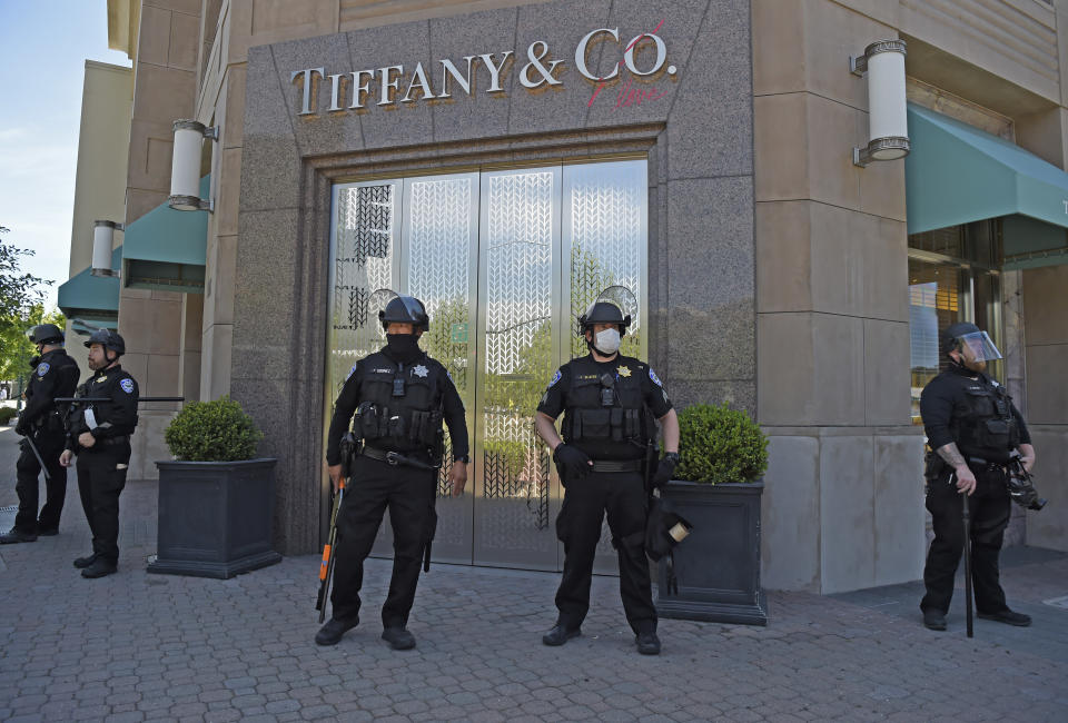WALNUT CREEK, CA - JUNE 1: Police stand guard at the Tiffany and Co. store in downtown Walnut Creek, Calif., on Monday, June 1, 2020. Walnut Creek Police issued a curfew tonight after looters descending into downtown and looted local businesses yesterday. Over 100 police officers from agencies around the county are in Walnut Creek awaiting a Black Lives Matter Protest being held tonight. (Jose Carlos Fajardo/Digital First Media/The Mercury News via Getty Images)