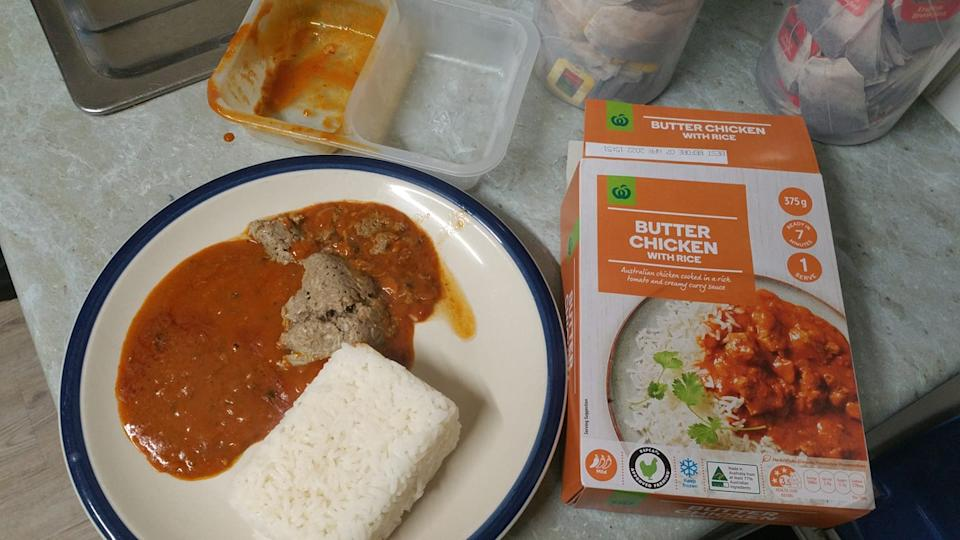A clump of grey substance seen on the plate of Butter Chicken from Woolworths.