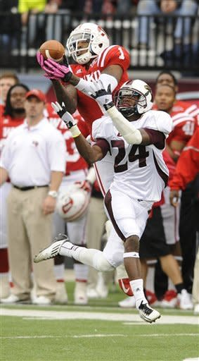 Western Kentucky's Jonathan Dowling (1) intercepts a pass intended for Louisiana-Monroe's Vincent Eddie (24) during the first half of an NCAA college football game in Bowling Green, Ky., Saturday, Oct. 20, 2012. (AP Photo/Daily News, Joe Imel)