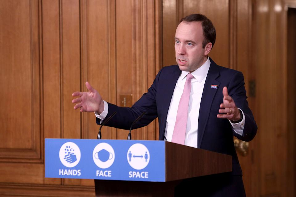 <p>Matt Hancock complying with notifications from NHS app</p> (AP)