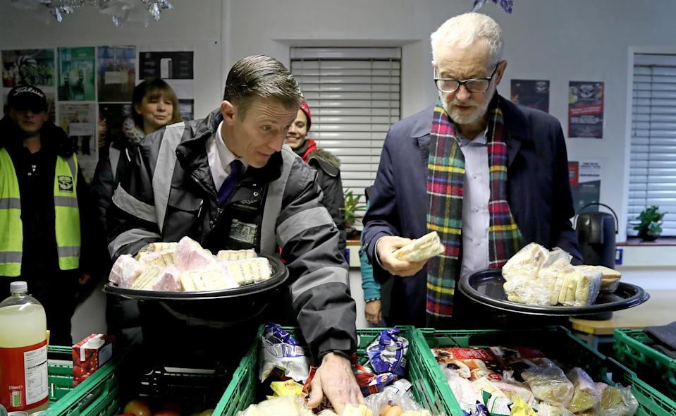 EMBARGOED TO 2230 WEDNESDAY DECEMBER 4 Labour Party leader Jeremy Corbyn helps to sort crates of food during a visit to Surviving the Streets in St. Leonards, East Sussex.