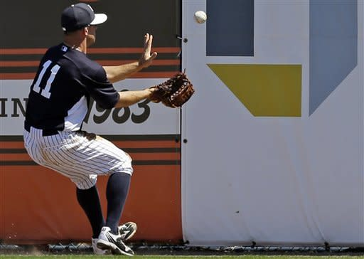New York Yankees centerfielder Brett Gardner (11) brings in Philadelphia Phillies' Jermaine Mitchell's fourth-inning triple off the outfield wall during a spring training exhibition baseball game in Tampa, Fla., Saturday, March 16, 2013. The Phillies won 7-0. (AP Photo/Kathy Willens)
