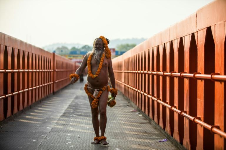 A holy man arrives to bathe in the Ganges river during the ongoing religious Kumbh Mela festival in Haridwar