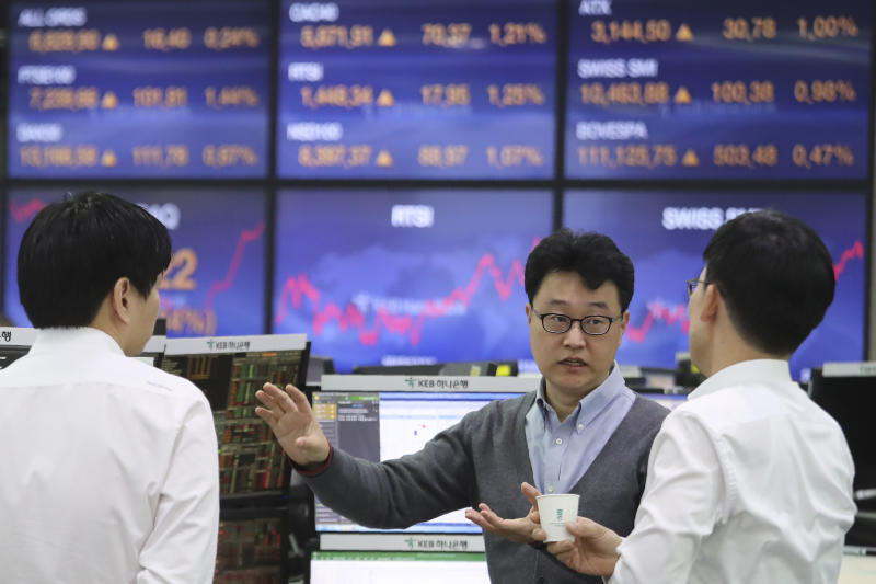 Currency traders work at the foreign exchange dealing room of the KEB Hana Bank headquarters in Seoul, South Korea, Monday, Dec. 9, 2019. Asian shares were mostly higher Monday cheered by a buying mood on Wall Street that came at the end of last week. (AP Photo/Ahn Young-joon)