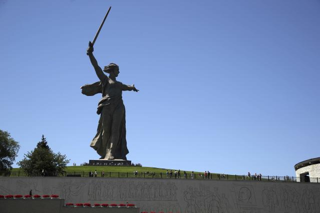 In this Sunday, June 17, 2018 photo, tourists visit the Motherland Calls monument which commemorates the victims of the Battle of Stalingrad, in which the Red Army turned back Nazi Germany's army in Volgograd, Russia. Nearly 60 years since it changed its name to Volgograd, the Russian city once called Stalingrad and its bloody history loom large even in the midst of the fun and football of the World Cup. (AP Photo/Thanassis Stavrakis)