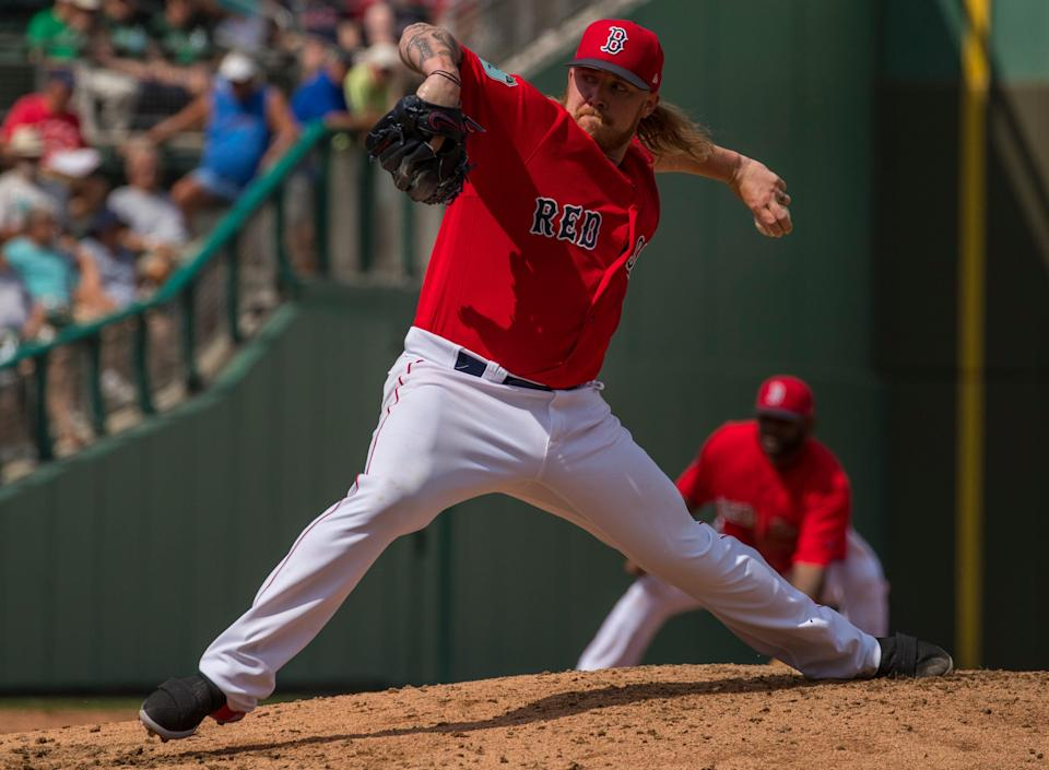 Boston Red Sox pitcher Robbie Ross Jr. winds up for a fast ball during the exhibition game at JetBlue Park against Team USA in Fort Myers, FL , Thursday, March 9.