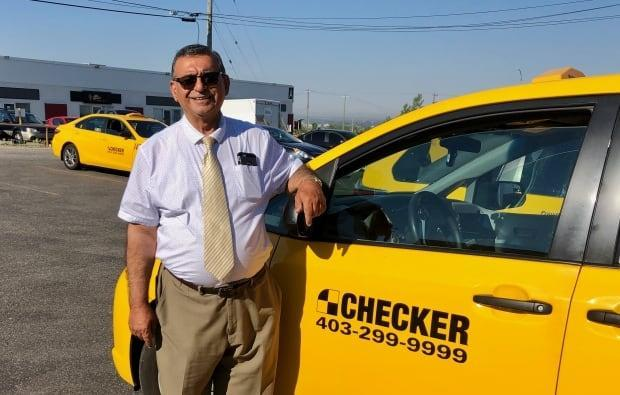 Iqbal Alimohd, a Checker Cabs driver, delivers groceries to dozens of seniors in Calgary every week free of charge. (Submitted by Checker Cabs - image credit)