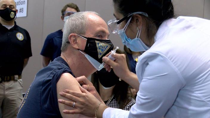 New Jersey Gov. Phil Murphy gets his first dose of the Pfizer COVID-19 vaccine administered by AtlantiCare RN Neha Desai at the Atlantic City, N.J., megasite Friday.