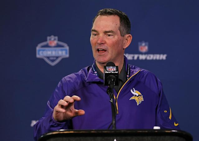Minnesota Vikings head coach Mike Zimmer answers a question during a news conference at the NFL football scouting combine in Indianapolis, Friday, Feb. 21, 2014. (AP Photo/Michael Conroy)
