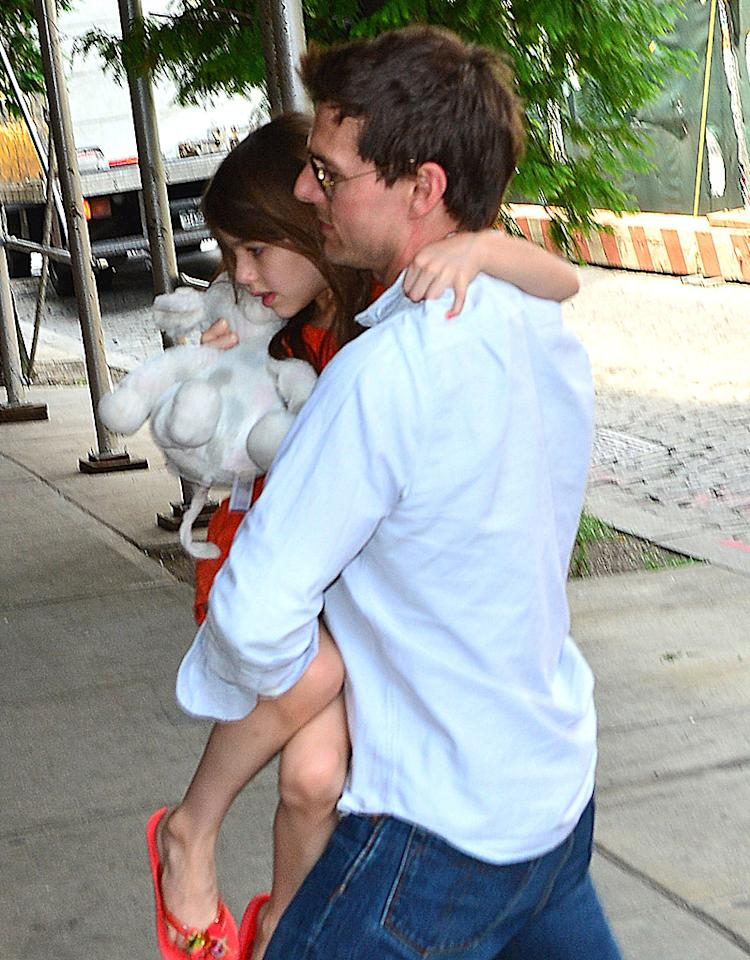 NEW YORK, NY - JULY 17:  (EXCLUSIVE COVERAGE) Tom Cruise and Suri Cruise seen on the Streets of Manhattan on July 17, 2012 in New York City.  (Photo by James Devaney/WireImage)