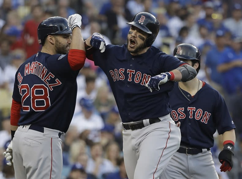 Boston Red Sox first baseman Steve Pearce celebrates the first of his two home runs in World Series Game 5. (AP)