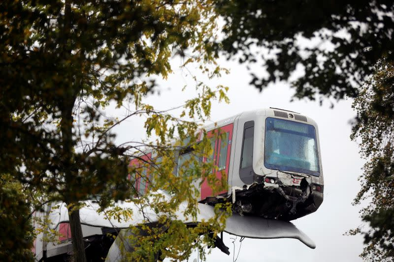 General view of a metro that crashed through a stop block and landed on an artwork of a whale tail at De Akkers subway station in Spijkenisse