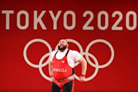 <p>Team Georgia's Lasha Talakhadze gets emotional after lifting 265kg to break the world record and win gold during the Weightlifting - Men's +109kg Group A at Tokyo International Forum on August 4.</p>