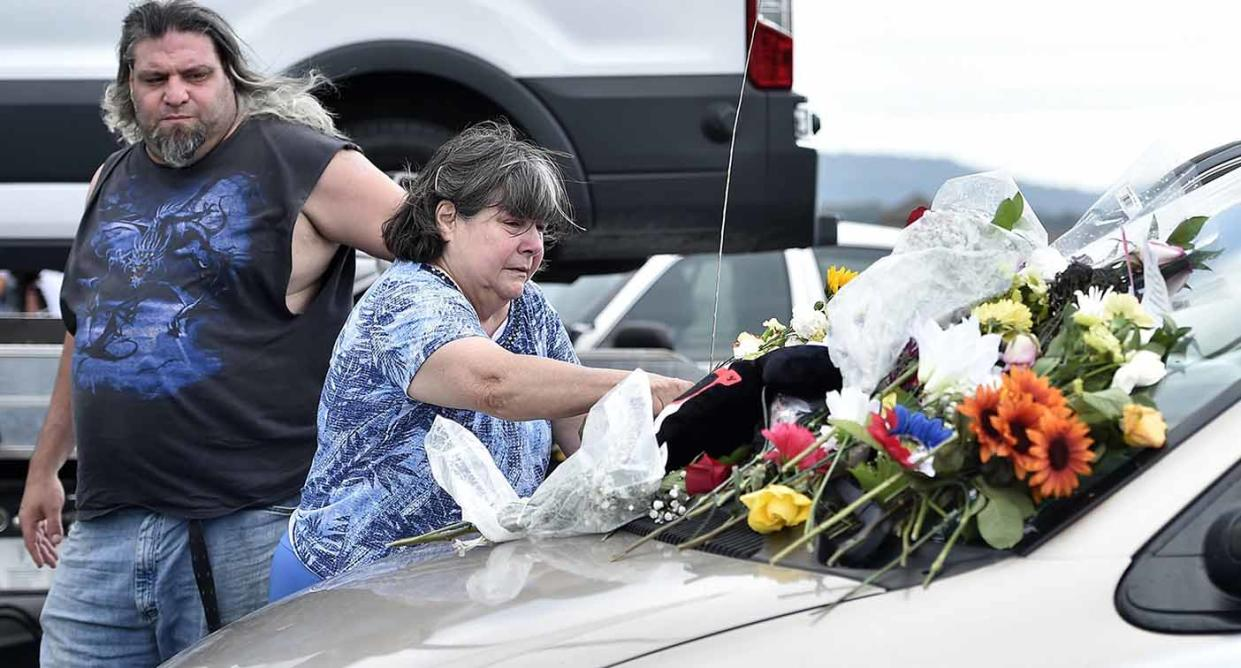 Flowers left on the vehicle of William and Janice Bright as a memorial were gathered by William Bright's sister Karen Abbot. Source: ABACA via AAP