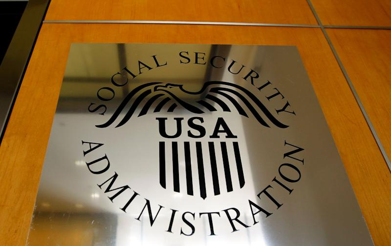 A sign for the Social Security Administration is seen in Los Angeles, Friday, July 29, 2011. If the debt ceiling currently being debated in Congress does not rise, the government would need to choose what to pay and what not, including benefits like Social Security. (AP Photo/Matt Sayles)
