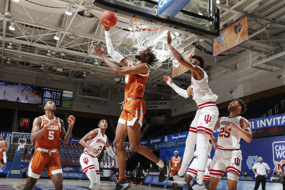 Texas Longhorns forward Greg Brown III (4) makes reverse layup against Indiana during the first half of a game on Nov. 30, 2020. (Brian Spurlock/Icon Sportswire via Getty Images)