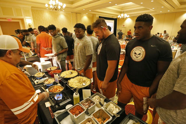 Members of the Texas Longhorns football team line up for dinner, Friday Sept. 6, 2019 at the team hotel in Austin, Tx. ( Photo by Edward A. Ornelas )