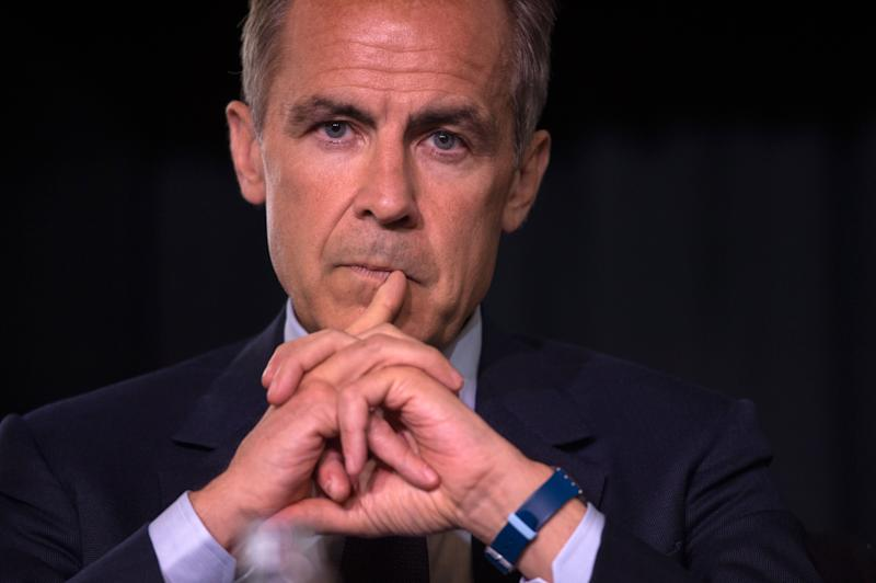 Mark Carney, governor of the Bank of England, attends at a press conference announcing the concept design for the new Bank of England fifty pound banknote, featuring mathematician and scientist Alan Turing, during the presentation at the Science and Industry Museum in Manchester, north-west England on July 15, 2019. (Photo by Oli SCARFF / AFP) (Photo credit should read OLI SCARFF/AFP/Getty Images)