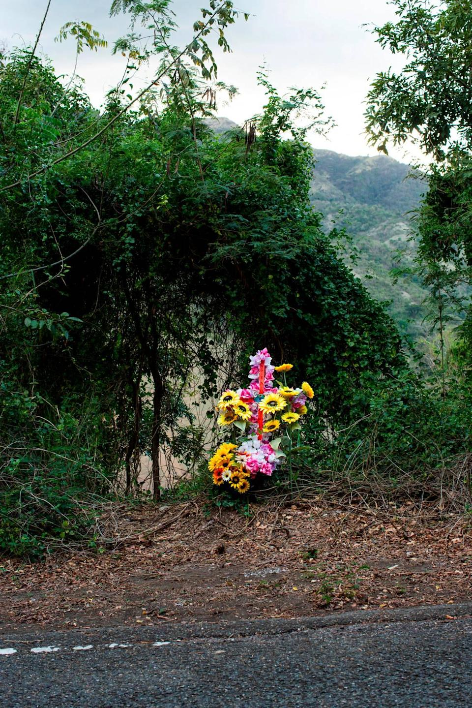 The roadside cross in Coamo, Puerto Rico, on March 21, 2021. The González Santos family erected the memorial to remember Angie González, who was allegedly killed by her partner of 16 years in January 2021.