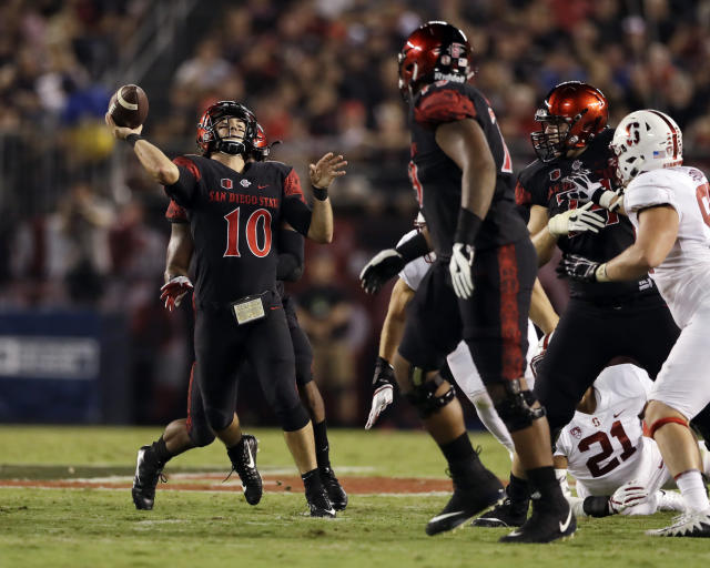 """San Diego State quarterback <a class=""""link rapid-noclick-resp"""" href=""""/ncaaf/players/245874/"""" data-ylk=""""slk:Christian Chapman"""">Christian Chapman</a> throws a pass during the first half of an NCAA college football game against Stanford Saturday, Sept. 16, 2017, in San Diego. (AP Photo/Gregory Bull)"""