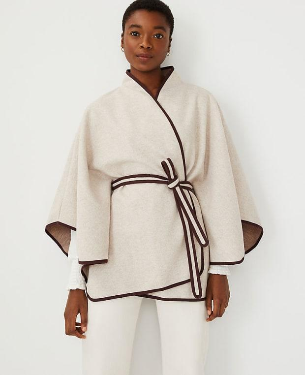 """<p>Ann Taylor Tipped Belted Cape, $118, <a href=""""https://rstyle.me/+ac3MvcAMHjEem3hnkG--yQ"""" rel=""""nofollow noopener"""" target=""""_blank"""" data-ylk=""""slk:available here"""" class=""""link rapid-noclick-resp"""">available here</a> (one size).</p>"""