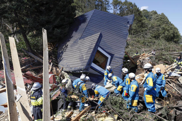 <p>Police search for missing persons around a house destroyed by a landslide after a powerful earthquake in Atsuma town, Hokkaido, northern Japan, Thursday, September 6, 2018. Several people were reported missing in the nearby the town, where a massive landslide engulfed homes in an avalanche of soil, rocks and timber. (Masanori Takei/Kyodo News via AP) </p>