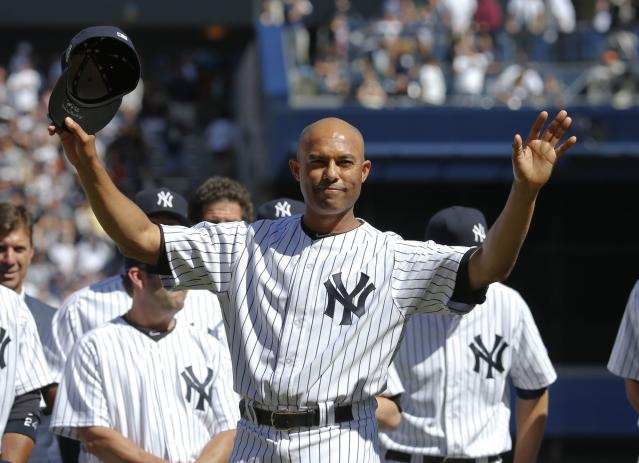 New York Yankees relief pitcher Mariano Rivera responds to the sold-out crowd during ceremonies honoring him before their MLB Interleague baseball game against the San Francisco Giants at Yankee Stadium in New York September 22, 2013. REUTERS/Ray Stubblebine (UNITED STATES - Tags: SPORT BASEBALL)