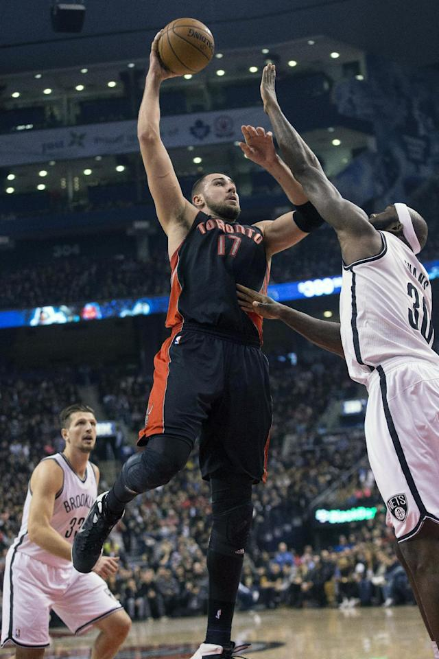 Toronto Raptors' Jonas Valanciunas (17) shoots on Brooklyn Nets Reggie Evans during the first half of an NBA basketball game, Saturday, Jan. 11, 2014 in Toronto (AP Photo/The Canadian Press, Chris Young)