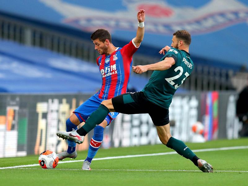 Joel Ward plays a pass for Crystal Palace: Getty